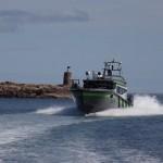 Bilde av båt i høy hastighet